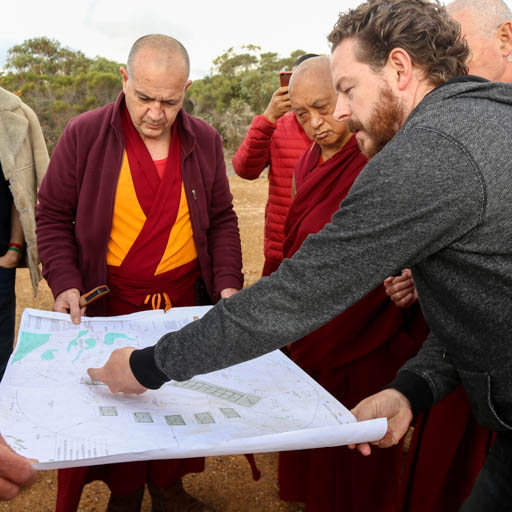 Lama Zopa Rinpoche discussing plans for a group retreat facility with Dale, the architect and Ven. Dondrub, De-Tong Ling Retreat Centre, Kangaroo Island, Australia, May 2015. Photo by Ven. Thubten Kunsang.