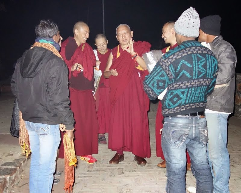 On the way down from Vulture's Peak, Lama Zopa Rinpoche stops to give teachings to the local Indians who sell things, February 2014. Photo by Ven. Roger Kunsang.