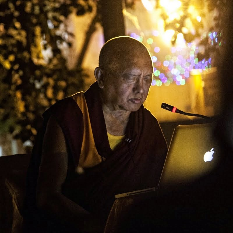 Lama Zopa Rinpoche giving an oral transmission of the Sutra of Golden Light at Mahabodhi Temple, Bodhgaya, India, March 2014. Photo by Andy Melnic.