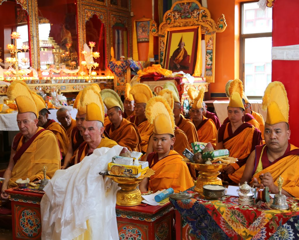 Young Tenzin Phuntsok Rinpoche sits with senior monks, including to his left Ven. Gyatso (Adrian Felmann) and Ven. Roger Kunsang, and geshes during long life puja for Lama Zopa Rinpoche, Kopan Monastery, December 12, 2014. Photo by Ven. Thubten Kunsang.