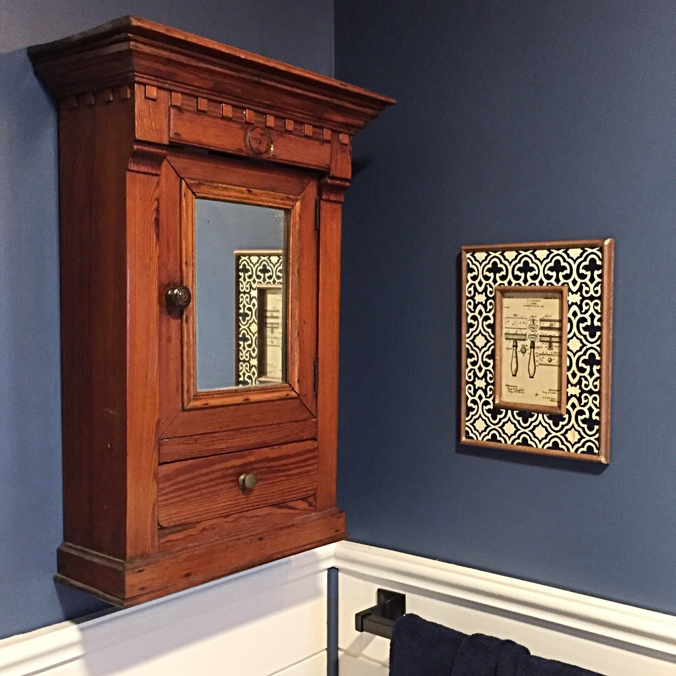 Splurged on this antique medicine cabinet I found on ebay. It's from Belgium. While the mirror wasn't large enough to put it above our sink, it fits nicely on the small wall next to the door and has plenty of space to store medication, etc. To the right, I made these patent prints and put them in some frames I found on super sale. There's a couple of them throughout the bathroom.