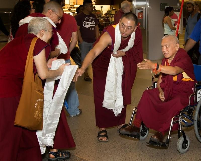 Sangha offering khatas to Lama Zopa Rinpoche, North Carolina, US, April 30, 2014. Photo by David Strevel.
