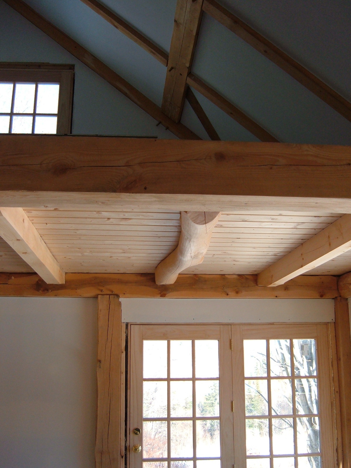 Curved yellow birch joist.