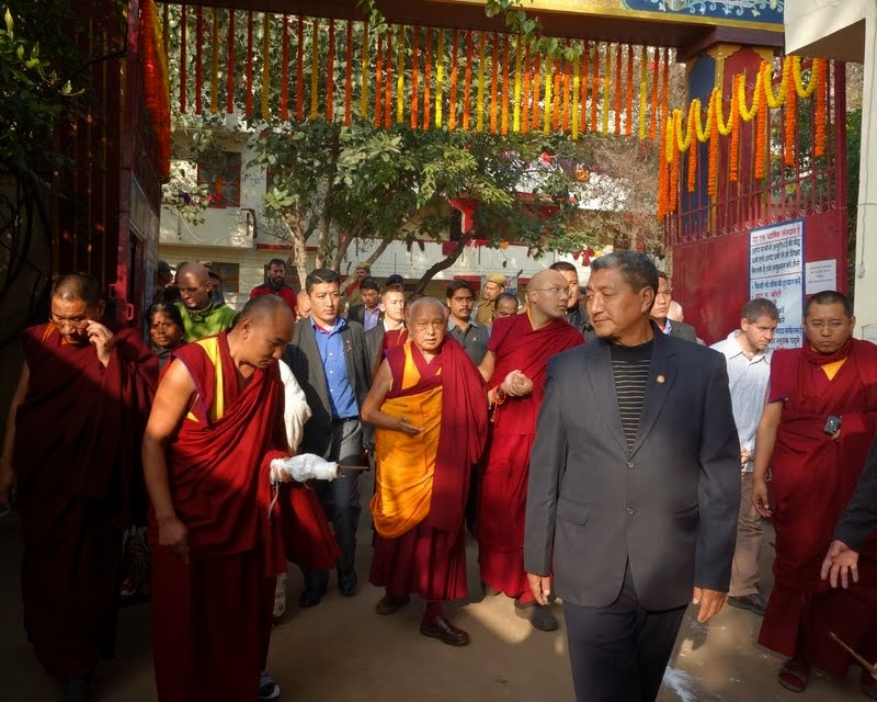His Holiness the Karmapa and Lama Zopa Rinpoche walking together as they arrive at Root Institute, Bodhgaya, India, January 2014. Photo by Ven. Roger Kunsang.