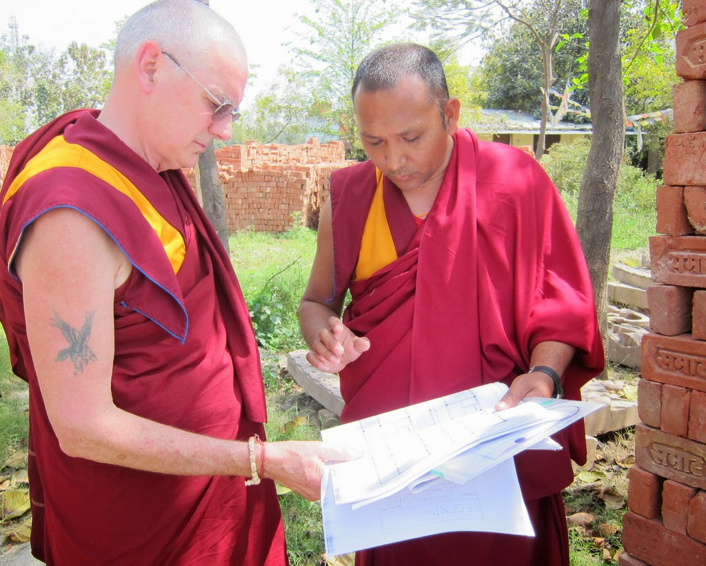 Ven. Roger Kunsang and Ven. Shenphen (Kopan's builder supreme!) discussing plans for the new nunnery building, Sarnath, India, March 2014. Photo by Ven. Sarah Thresher. A kind benefactor donated all the bricks that will be used to build the new accomodations for the nuns.