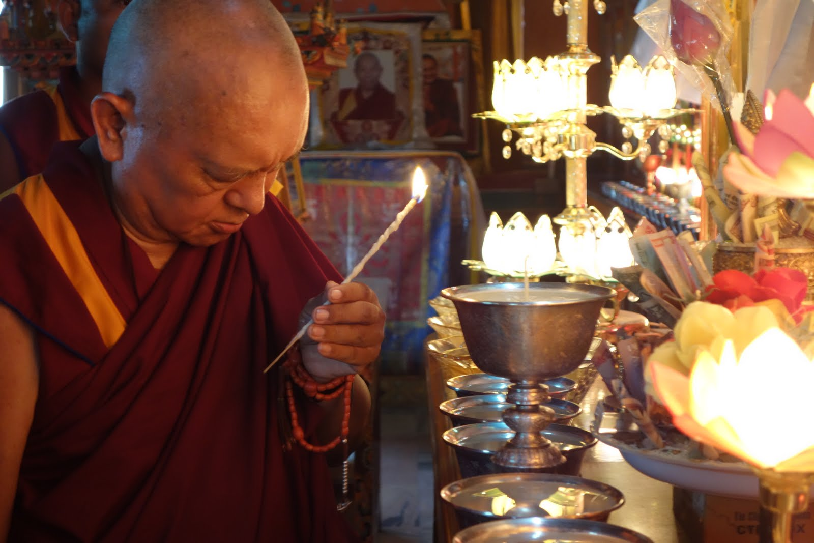 Rinpoche offering butter lamp. August 8, 2013 Photo: Ven. Roger Kunsang