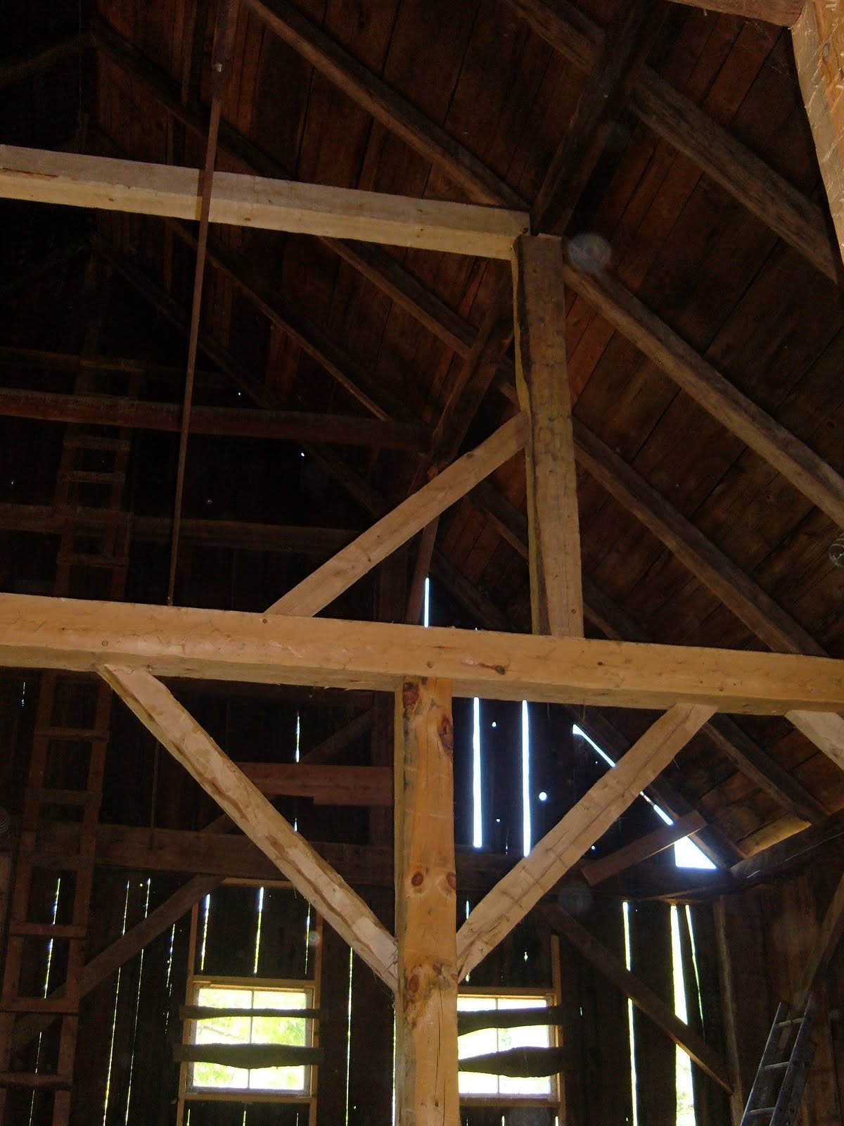 On top of the new bent we added a purlin post and staining beam to help support the roof.