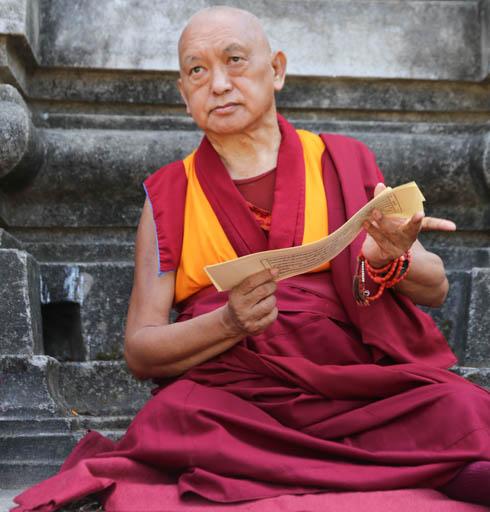 "Lama Zopa Rinpoche reading Lama Tsongkhapa's ""Lekshe Nyingpo,"" Mahabodhi Stupa, Bodhgaya, India, March 2015. Photo by Ven. Thubten Kunsang."