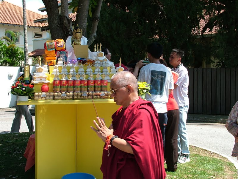 Lama Zopa Rinpoche circunambulating the altar during an Animal Liberation in Singapore