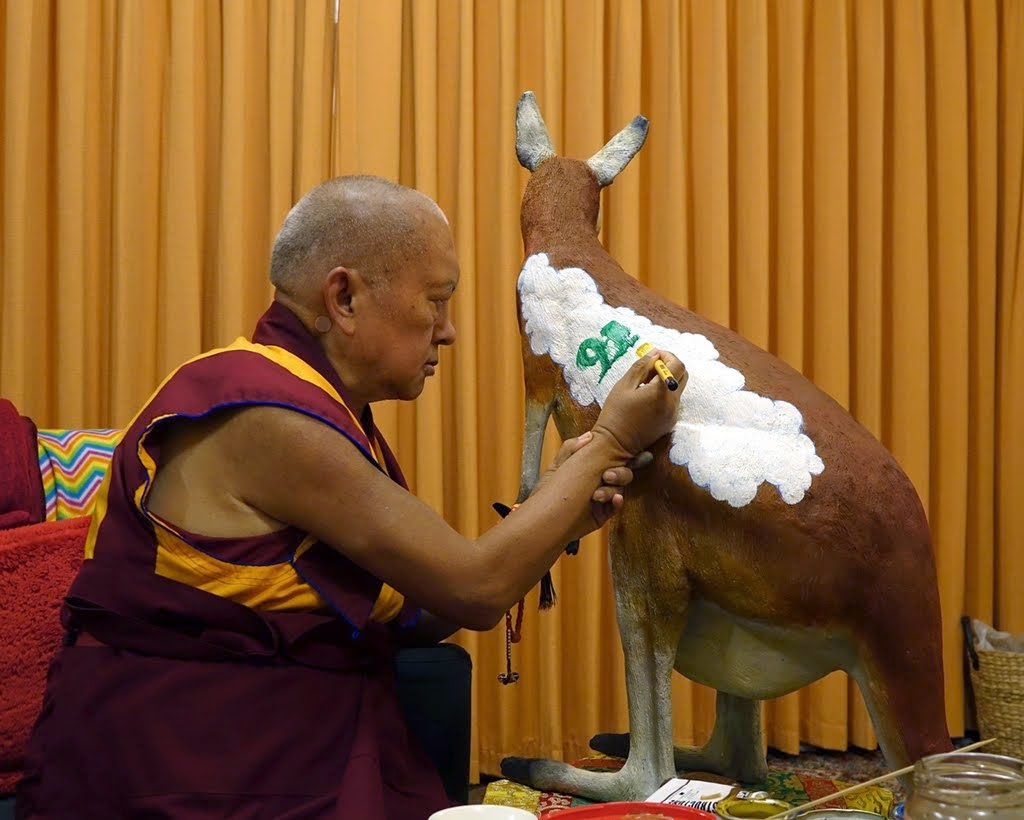 Lama Zopa Rinpoche painting a mantra on a kangaroo statue to be placed outside, Thubten Shedrup Ling, Australia, October 2014. Photo by Ven. Roger Kunsang.