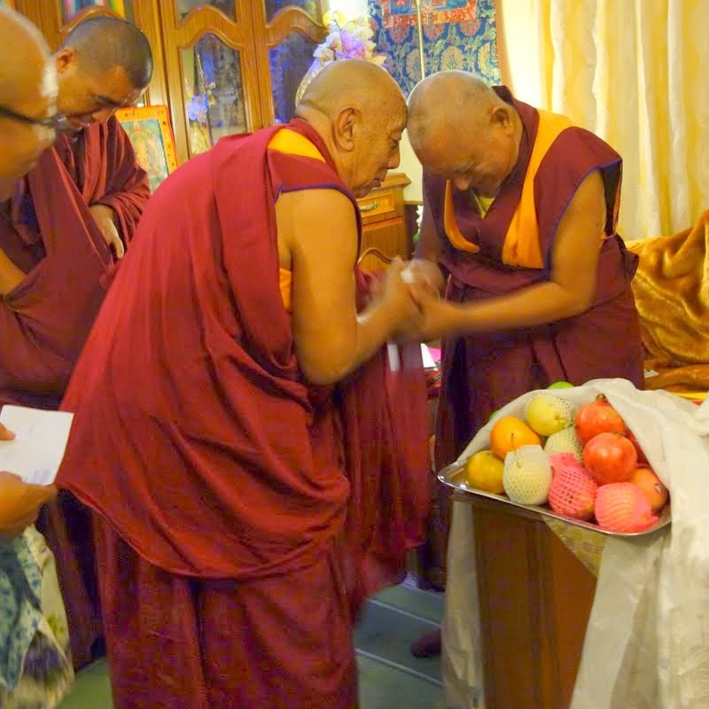 Sera Je abbot greeting Lama Zopa Rinpoche, Sera Je Monastic University, India, December 2013. Photo by Ven. Roger Kunsang.