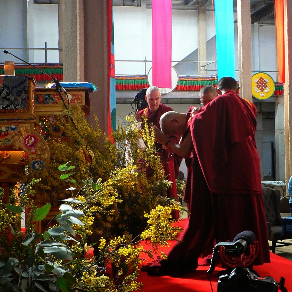 Rinpoche prostrating before offering the body, speech and mind mandala to a photo of His Holiness the Dalai Lama on the throne, Great Stupa of Universal Compassion, Australia, September 13, 2014. Photo by Laura Miller.