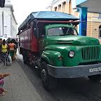 People bording a camion - public truck transport