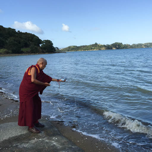 Lama blessing the ocean and all sentient beings in it on way to Auckland airport, New Zealand, May 2015. Photo by Ven. Thubten Kunsang.