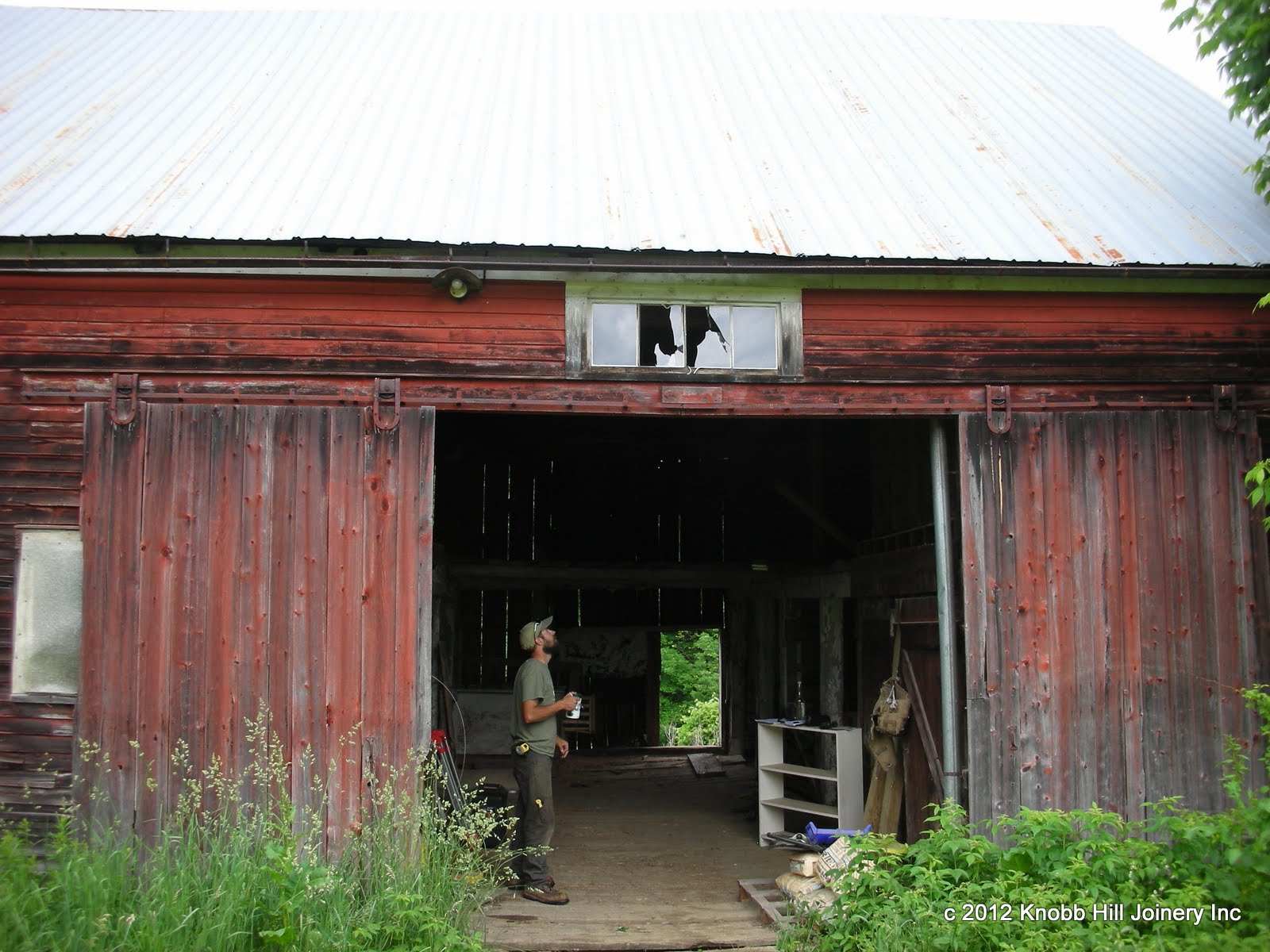 Two sides of the barn facing the road had been clapboarded in the late 1800's.
