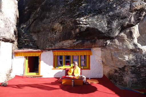Lama Zopa Rinpoche in front of his meditation cave at Lawudo, Nepal, April 2015. Photo by Ven. Roger Kunsang. Rinpoche visited Lawudo for three weeks in April 2015, leaving on April 24, the day before the devastating Nepal earthquake.