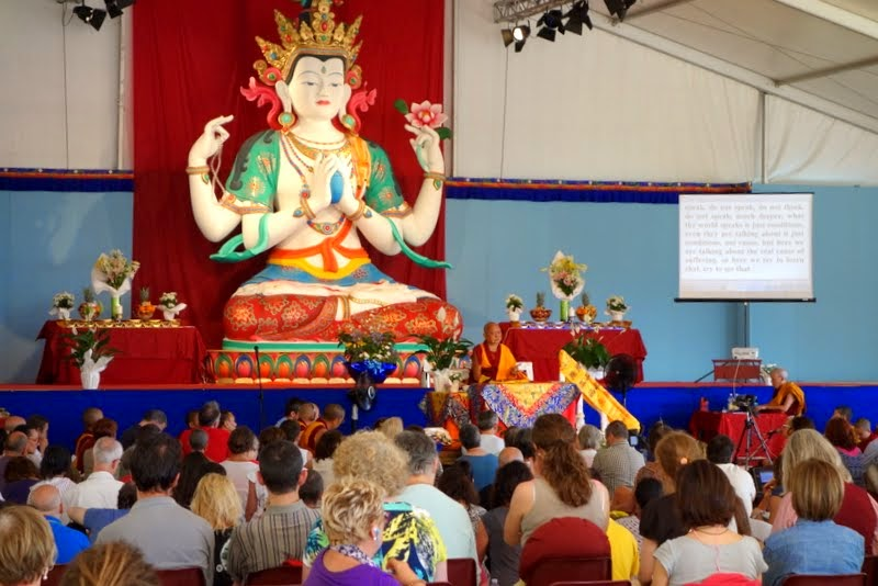 Lama Zopa Rinpoche teaching in front of the newly restored Chenrezig Statue at ILTK, Pomaia, Italy, June 28, 2014. Photo by Ven. Roger Kunsang.