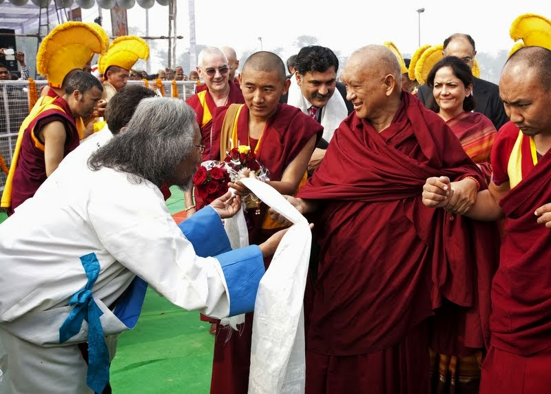 Lama Zopa Rinpoche being greeted as he arrives for the Maitreya Project ceremony at Kushinagar, India, December 13, 2013. Photo by Andy Melnic.