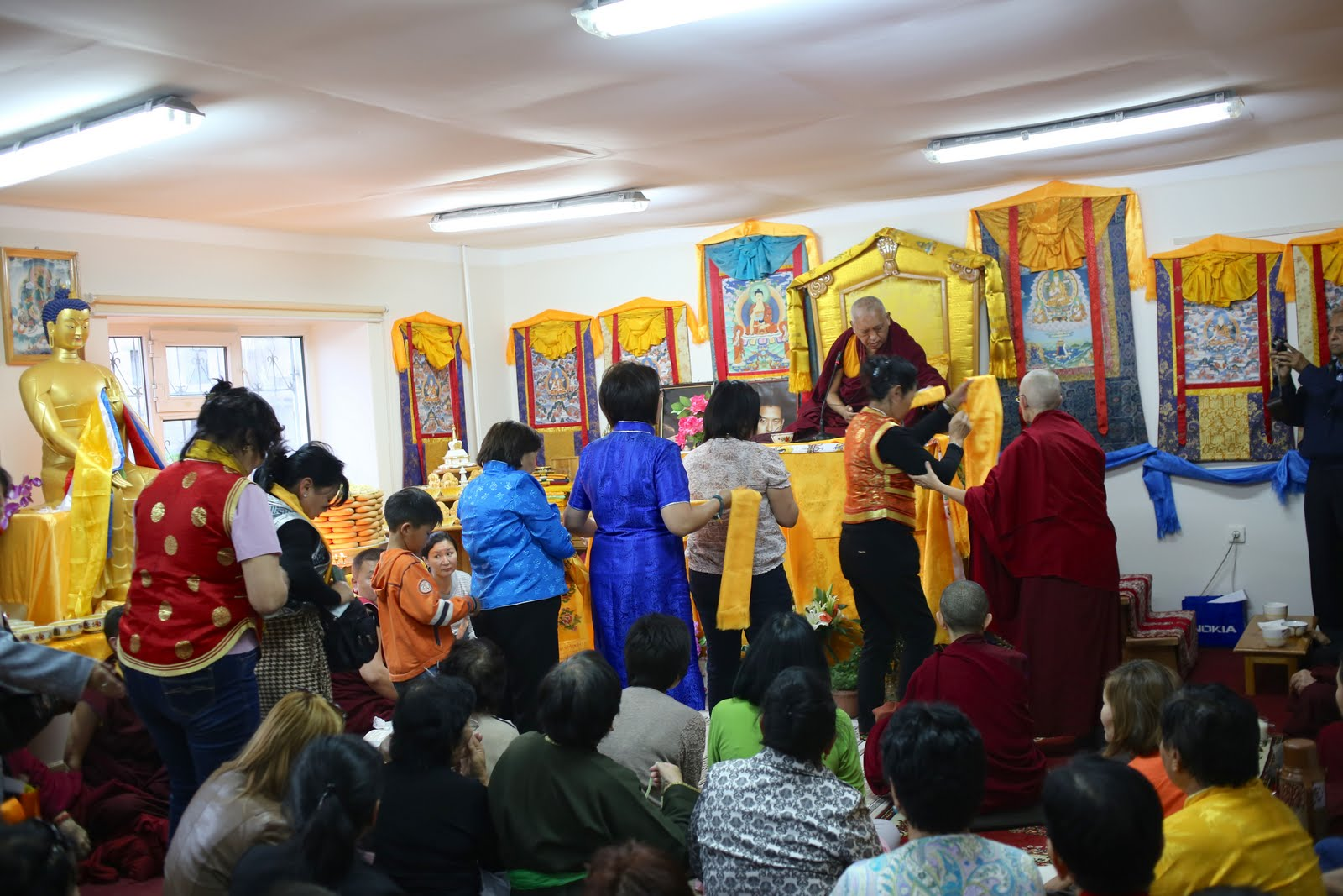 Students of Golden Light Sutra Center offering Rinpoche the Golden Light Sutra they have written in gold for him. September 2013. Photo: Ven. Thubten Kunsang