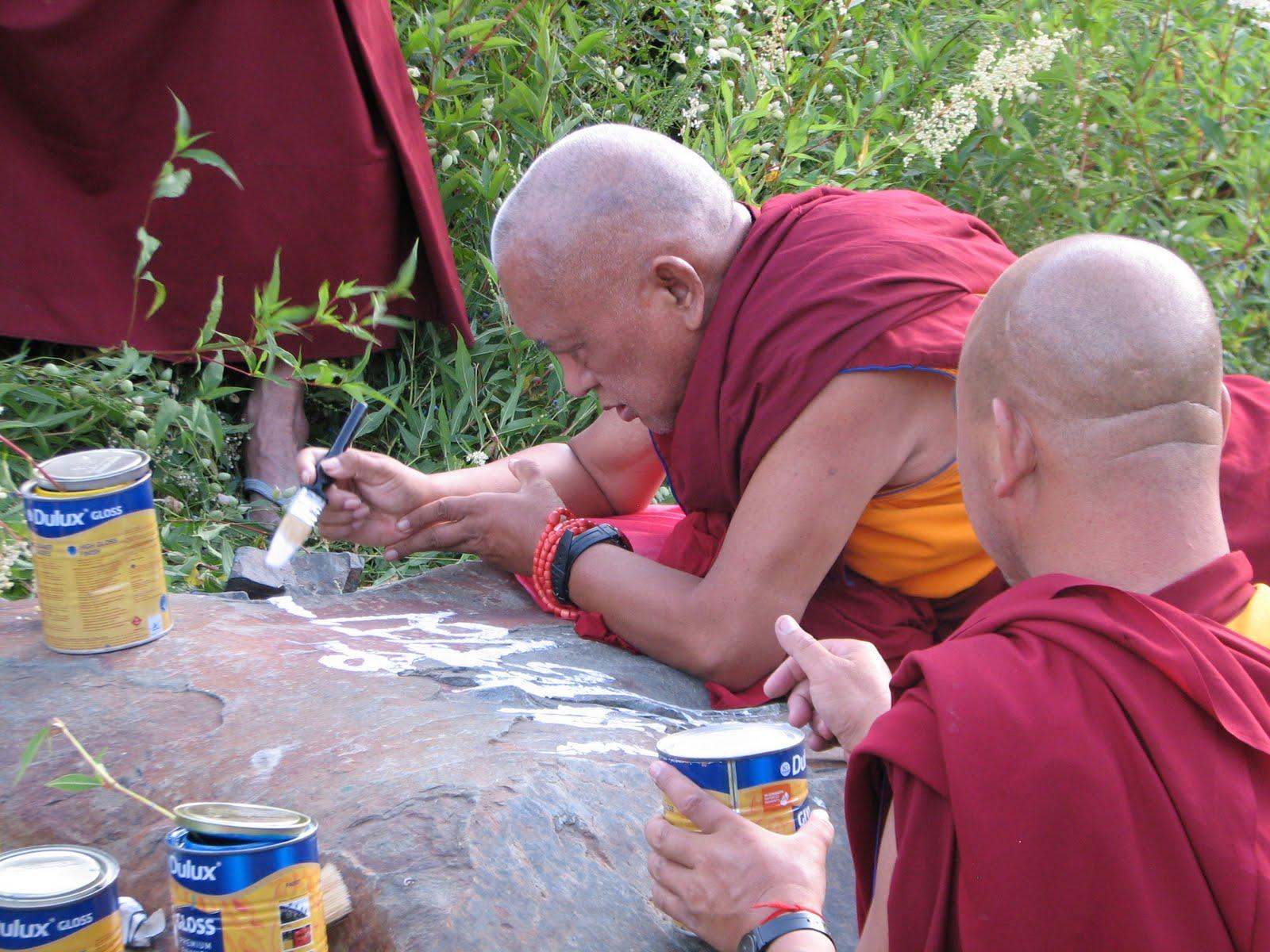 Rinpoche painting mantras on rock, Manali, India, July 24, 2013. Photo by Maya.