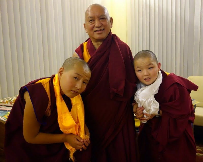 Lama Zopa Rinpoche with two of the young Mongolian tulkus who are studying at Sera Je, India, December 2013. Photo by Ven. Roger Kunsang.