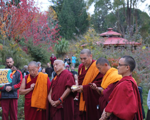 Lama Zopa Rinpoche with Geshe Wangchen and Geshe Tharchin blessing large Buddha statue at Chandrakirti Centre, New Zealand, May 2015. Photo by Ven. Thubten Kunsang.