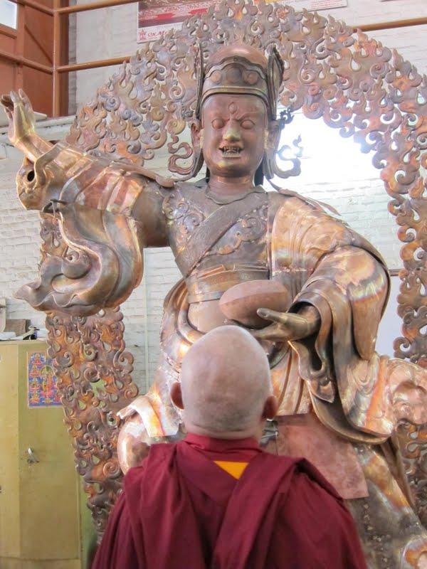 Lama Zopa Rinpoche checking the art of the Padmasambhava statues for Lawudo