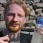 """Drinking """"Sherpa beer"""" - some fermented rice drink. Climbers only drink on the way down."""