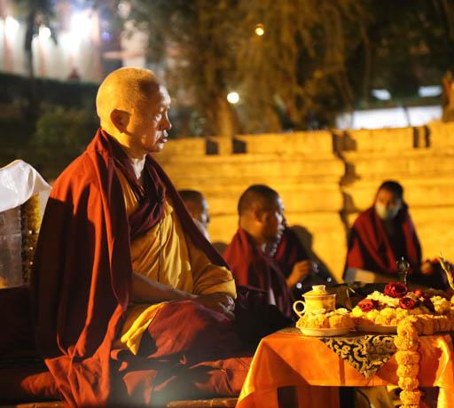Lama Zopa Rinpoche offering 1,000 tsogs at Mahabodhi Stupa at night, Bodhgaya, India, February 2015. Photo by Ven. Thubten Kunsang.