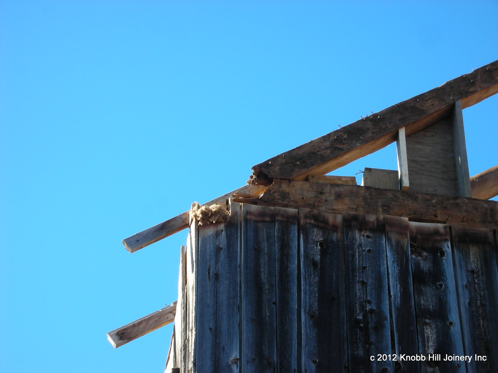 The sheathing of the barn may have been doing more to hold the frame together than the timber.