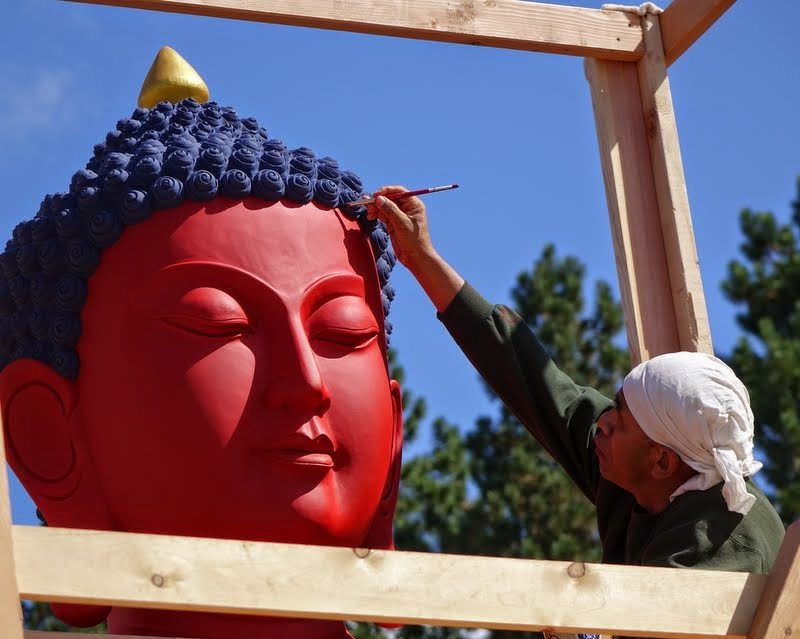 Gelek Sherpa painting the head of the statue, Buddha Amitabha Pure Land, Washington, US, August 2014. Photo by Ven. Roger Kunsang.