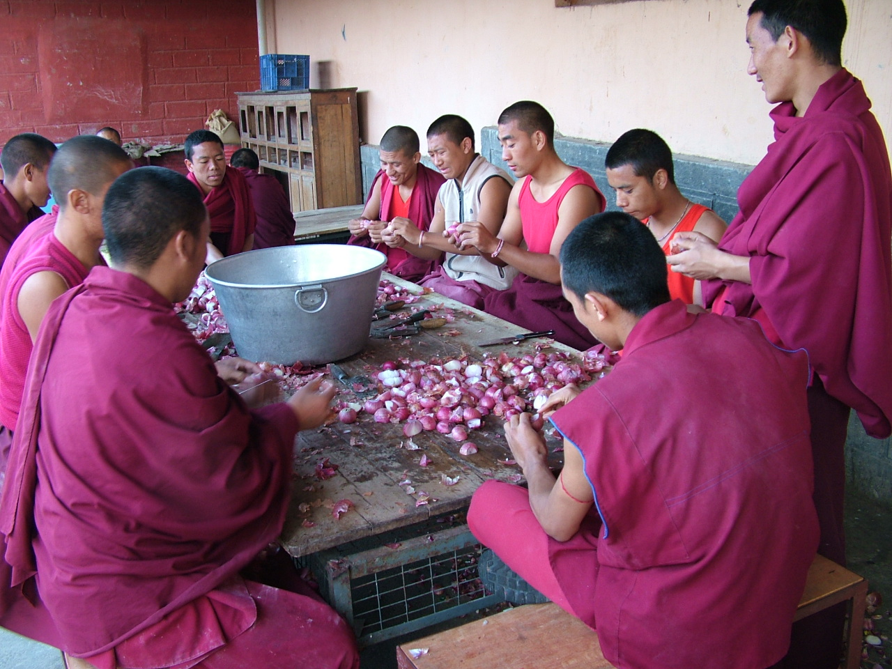 Monks participating in the making of food