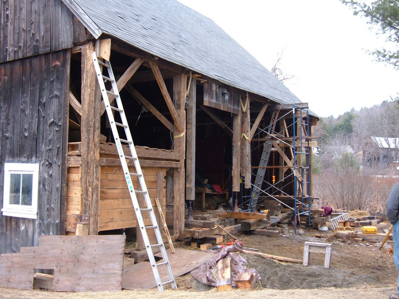 The post feet and step sill system of this late 1700's barn had extensive rot .