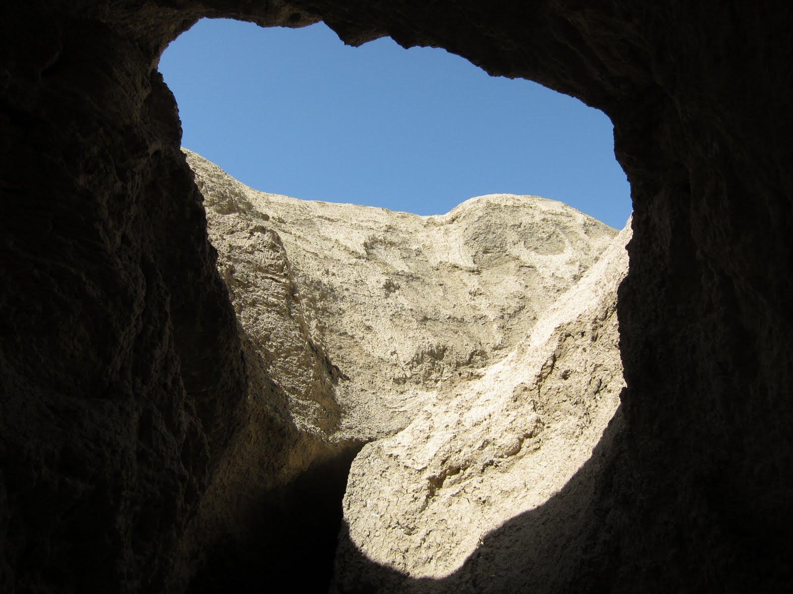 Blue desert sky above the large slot canyon