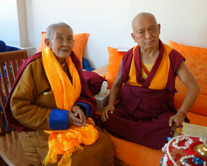 Lama Zopa Rinpoche during a visit with a Mongolian nun, who is 103 years old, Ulaanbaatar, Mongolia, August 2014. Photo by Ven. Roger Kunsang. Ven. Roger shares that the nun came wanting advice on how to end her life soon as she experiences so much suffering and it is difficult to bear.