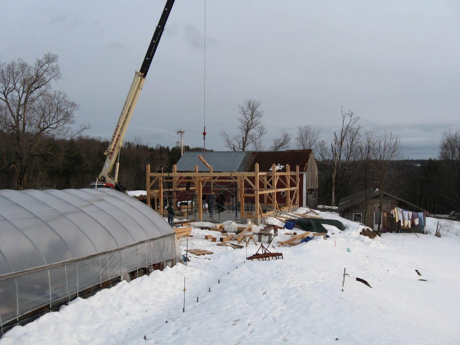 Floor joists are flown into place before the plates are added.