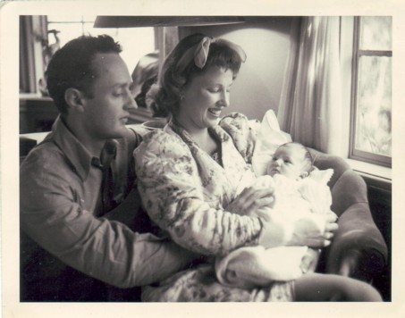Feather Meston as a baby with parents.