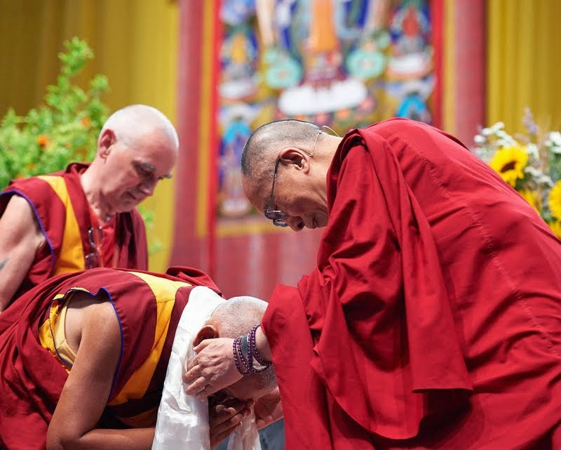 Lama Zopa Rinpoche receiving a khata from His Holiness the Dalai Lama, Livorno, Italy, June 15, 2014. Photo by Olivier Adam.