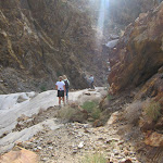 Navigating back down the dry waterfall in Rockhouse Canyon