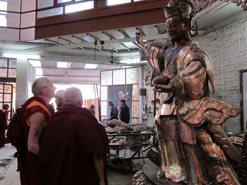 Lama Zopa Rinpoche checking on the progress of the Padmasambhava statues for Lawudo