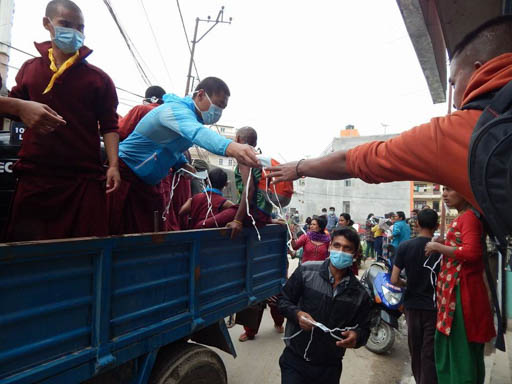 Kopan monks distributing facemasks after the earthquake, Kathmandu, Nepal, April 2015