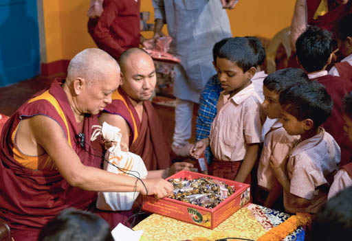 Lama Zopa Rinpoche with Maitreya School students, Root Institute, India, March 2015. Photo by Andy Melnic.