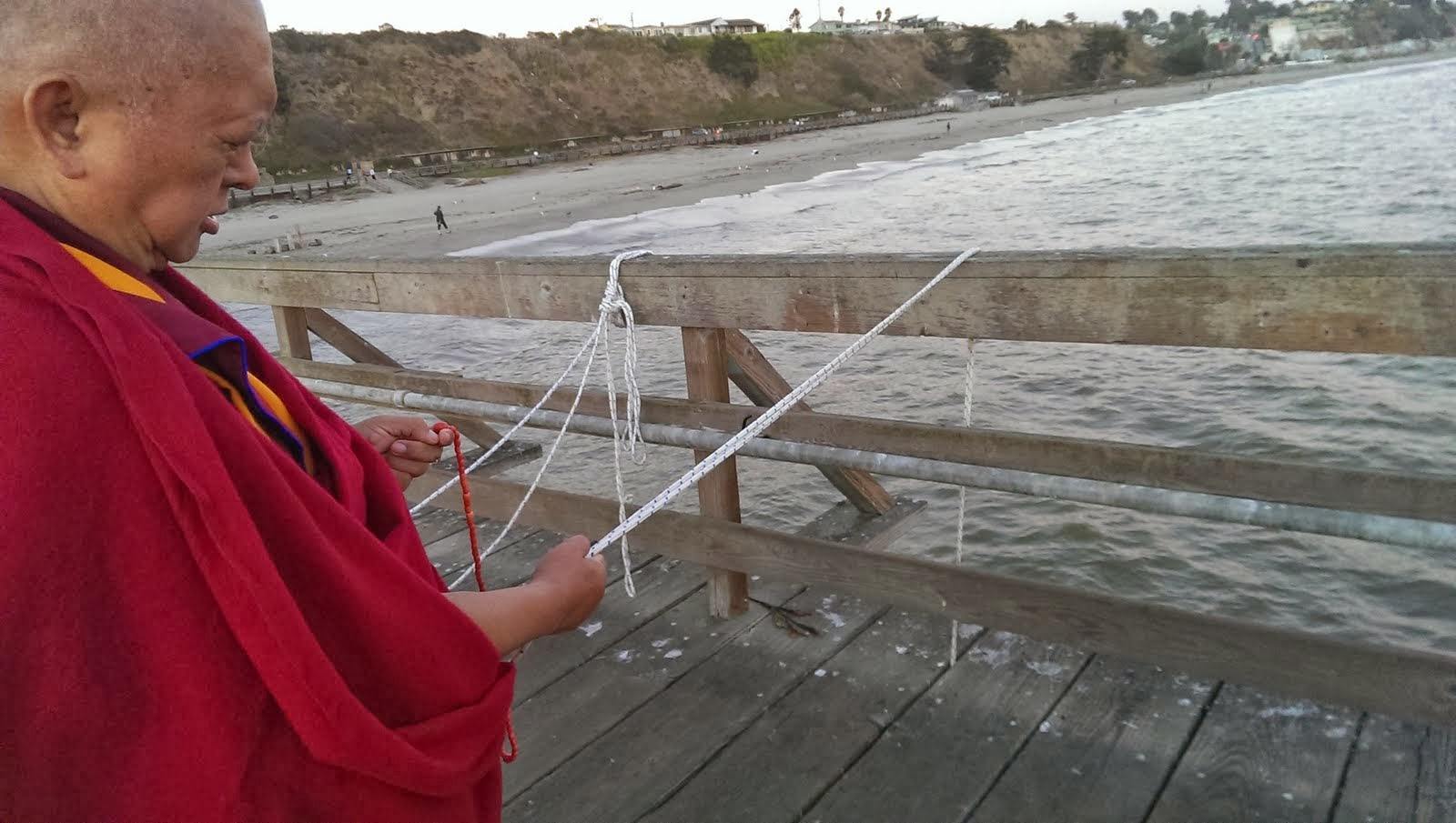 Rinpoche blessing the ocean and all the beings living there. Aptos, California. Sep 13, 2103. Photo: Ven. Roger Kunsang