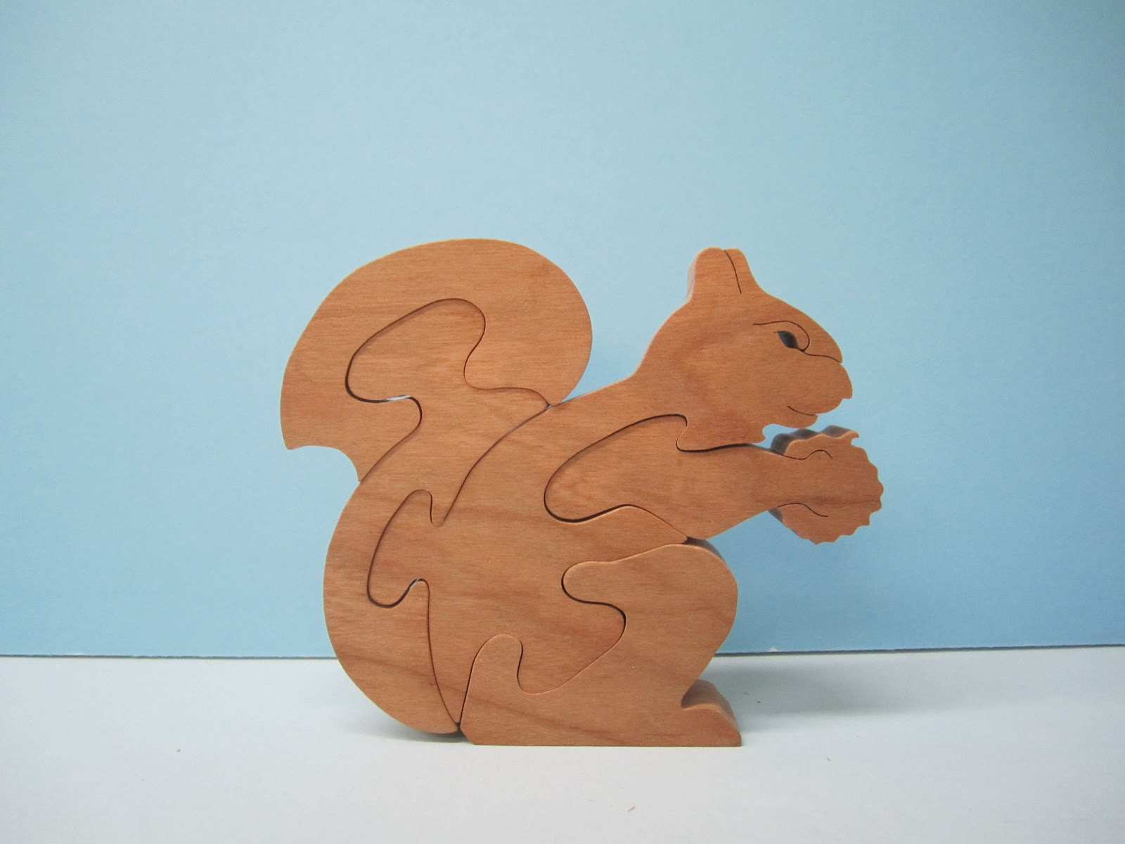 Squirrel  by Judy and Dave Peterson cherry  4 1/2 x 5