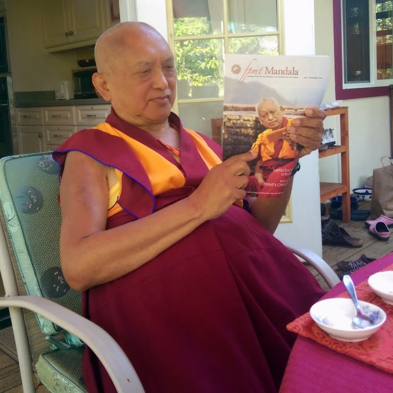 Lama Zopa Rinpoche reading the July-September 2014 issue of Mandala, Kachoe Dechen Ling, Aptos, California, June 2014. Photo by Ven. Roger Kunsang.