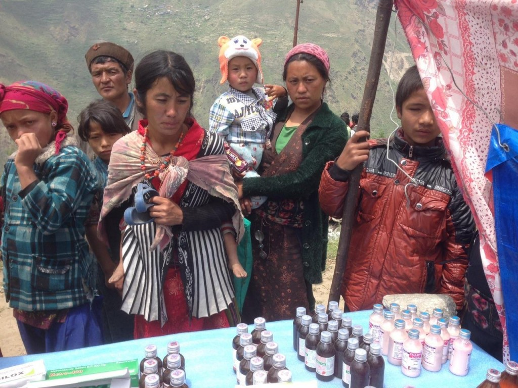 Providing medical aid in Rasuwa District, Nepal, May 2015.