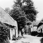 High Street, showing Sign of the Crown and the Old Forge on the right. Cottages on the left were demolished in the 1960s