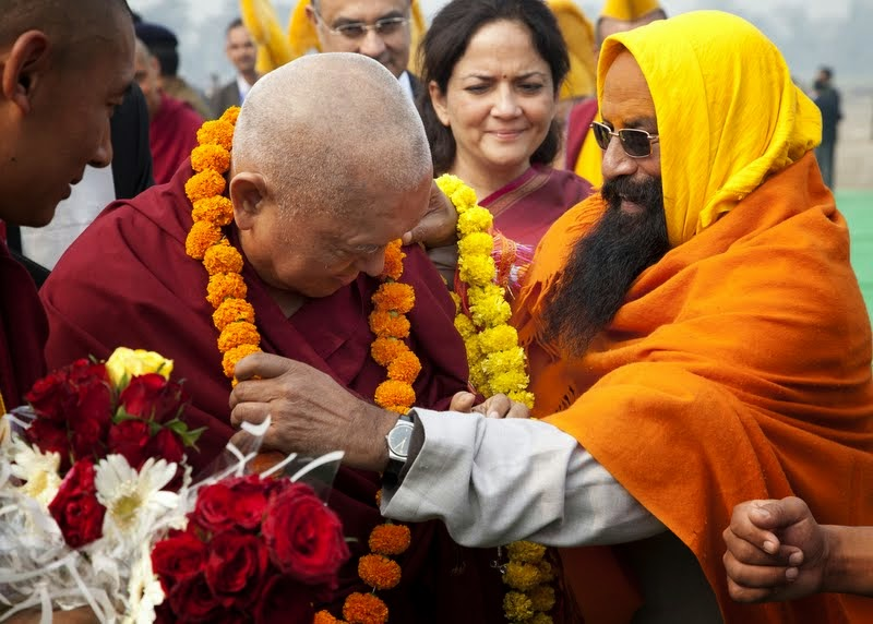 Lama Zopa Rinpoche being given a marigold garland as he arrives for the Maitreya Project ceremony at Kushinagar, India, December 13, 2013. Photo by Andy Melnic.