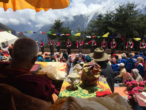 Lama Zopa Rinpoche watches Sherpa women make a dance offering during the Amitabha long life initiation at Lawudo Retreat Centre, Nepal, April 2015. Photo by Ven. Roger Kunsang.