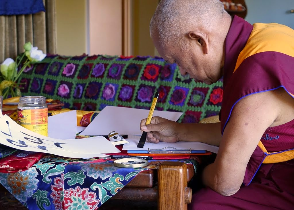 Lama Zopa Rinpoche practicing calligraphy in his room at Thubten Shedrup Ling, Bendigo, Australia, October 2014. Photo by Ven. Roger Kunsang.